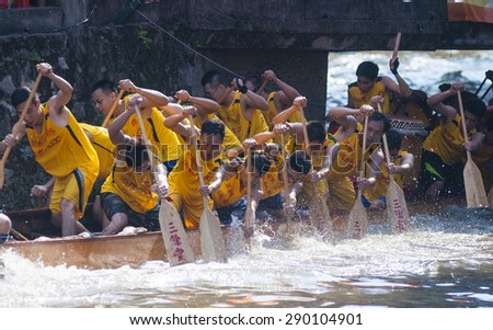 FOSHAN-June 20:The Dragon Boat Festival dragon boat in Fen rivers, there are 17 dragon boat teams took part in the game, attracted tens of thousands of people watched June 20, 2015 in Foshan, China - stock photo