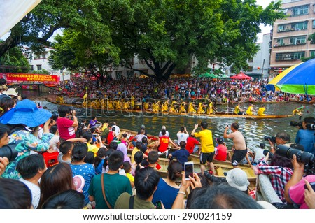 FOSHAN-June 22:Third Dragon Boat Festival dragon boat race held in Fen rivers, a total of 16 dragon boat ship, there are tens of thousands of people watched, elegantly June 22, 2015 in Foshan, China - stock photo