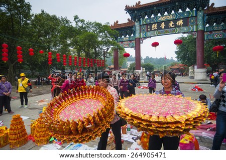 FOSHAN MAY 16:26 of the Chinese New Year is the day when the buddist goddess of mercy open library, the faithful offerings to guanyin temple consecrate paper May 16, 2015 in Foshan, China - stock photo