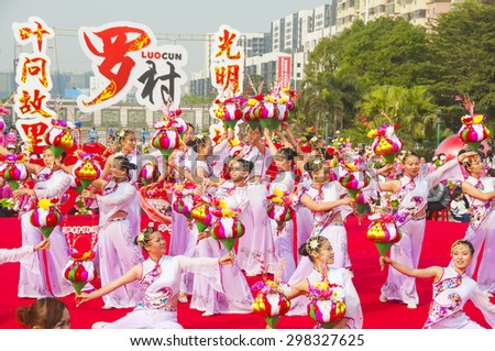 FOSHAN-Nov 29:In order to meet the arrival of the New Year, female dancers dressed in traditional costumes performing flower-lantern dance in the square Nov 29, 2010 in Foshan, China - stock photo