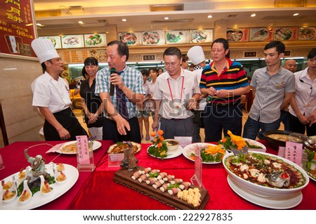 FOSHAN Sep 15:Speciality contest held in the grand hotel, 30 chefs to produce 60 speciality to participate in the selection, finally choose the 10 most popular speciality Sep 15, 2014 in Foshan, China - stock photo