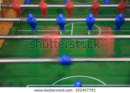 fossball table game in action, motion blur - stock photo