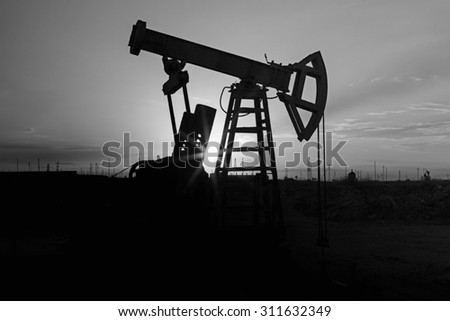 Fossil Fuel Energy, Oil Pump, Pumpjack, Old Pumping Unit, Jack Pump, Sunset.Rows of oil donkey in silhouette at sunset  crude oil.  - stock photo