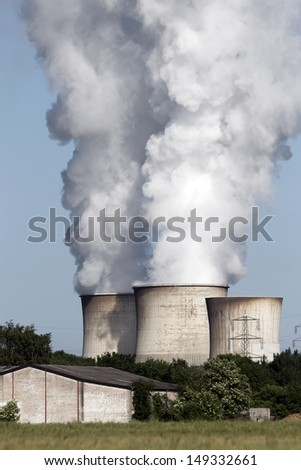 Fossil-fuel power station emission - stock photo