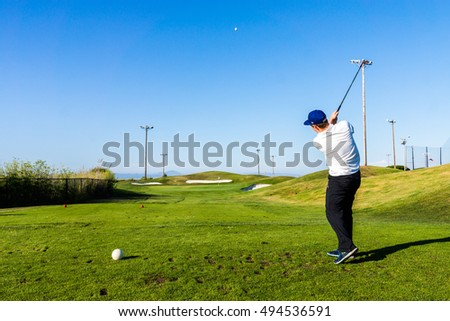 FOSTER CITY, CALIFORNIA - CIRCA JULY 2015: A man plays golf on a golf course in Foster City, California.