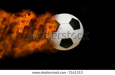 fotball in motion, making a firetrack - stock photo