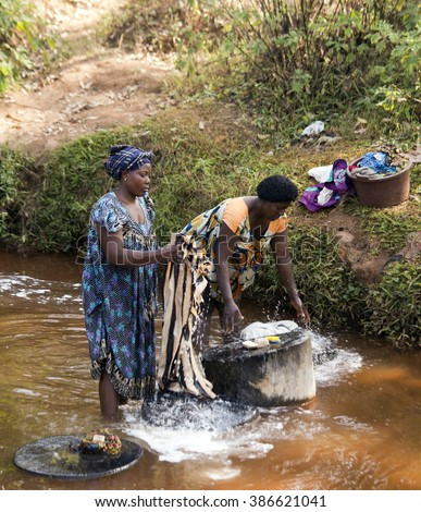 FOUMBAN - CAMEROON / 18.01.2015: African woman are washing their clothes in the river