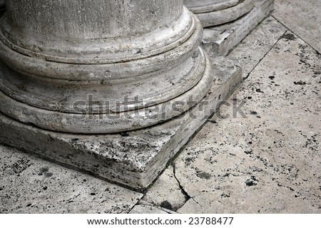 foundation of old column on the stone floor - stock photo