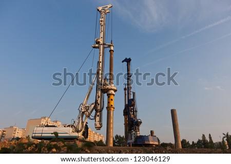 Foundation piles drilling machine - stock photo