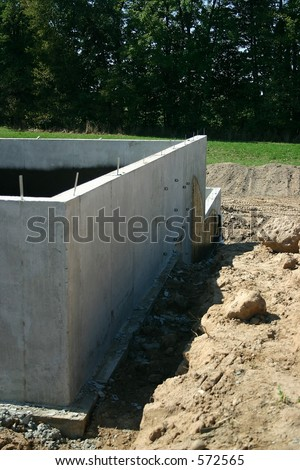 Foundation to an attached garage of a new home. - stock photo