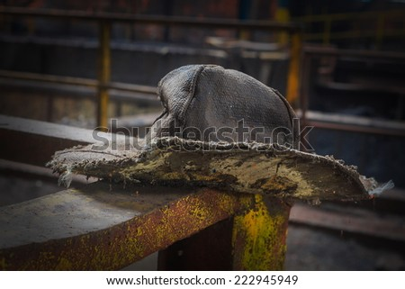 Foundry forgotten hat in an abandoned blast furnace - stock photo
