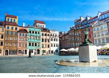 Fountain and colorful old houses on old town marketplace square in Warsaw, the capital of Poland - stock photo