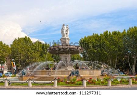 fountain at La Rotonde at sunset, Aix-en-Provence, Provence, France - stock photo
