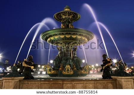 Fountain at Place de la Concord by dusk - stock photo