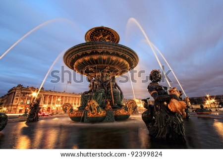 Fountain at Place de la Concord in Paris France  by dusk - stock photo