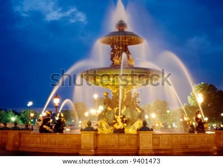Fountain at the Place de la Concorde in the evening - stock photo