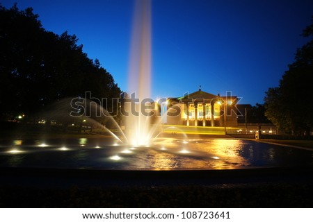 fountain before opera house in Poznan at night, Poland - stock photo