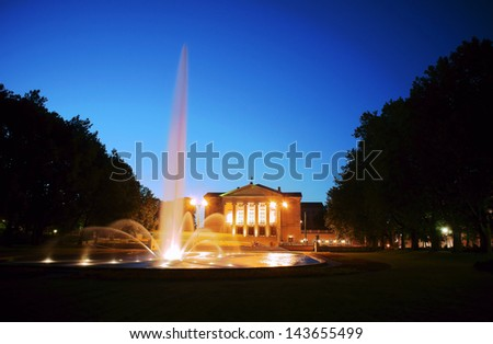 fountain before opera house in Poznan at night, Poland
