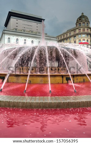 Fountain de ferrari Genoa Italy turns pink / red to raise awareness among women in the fight against breast cancer (hdr image)