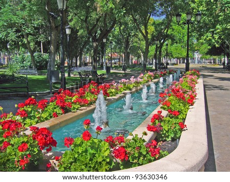 Fountain in a park of spanish village - stock photo