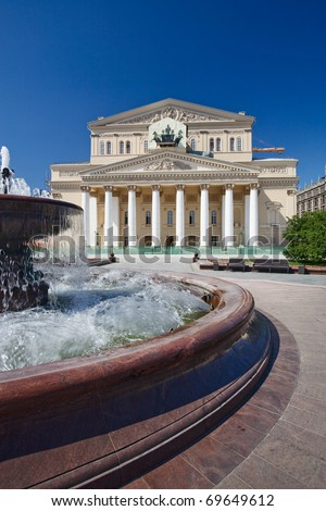 Fountain in front of the Bolshoi Theatre, building under restoration, covered quadriga, Moscow, Russia - stock photo