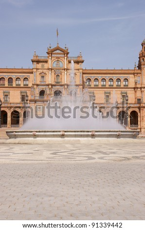 Fountain in front of the main entrance of Plaza de Espana in Seville. Plaza de Espana was designed by Anibal Gonzalez for the Ibero-American Exposition World's Fair.