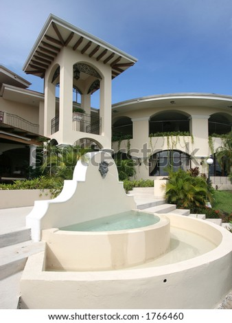 Fountain in front of Tropical Hotel - stock photo