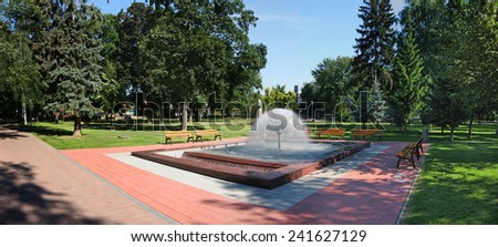 fountain in park and green grass - stock photo