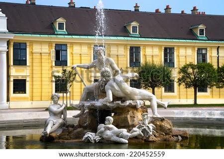 Fountain in Schonbrunn palace courtyard, Vienna, Austria - stock photo