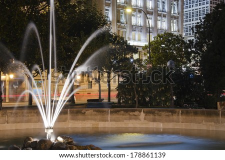 fountain in the park at night - stock photo