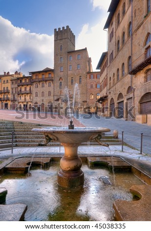 Fountain in the Piazza Grande, Arezzo, Italy - stock photo