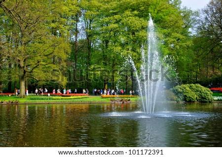 Fountain in the river in Keukenhof park in Holland - stock photo