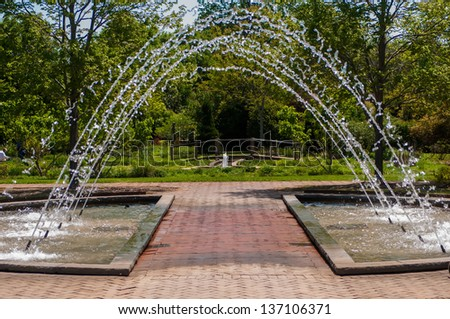 fountain inbotanic  Garden with beautiful nature - stock photo