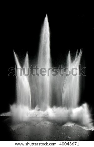 Fountain isolated on black background - stock photo