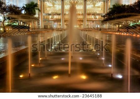 Fountain near Petronas Twins Towers by night, Kuala Lumpur, Malaysia - stock photo