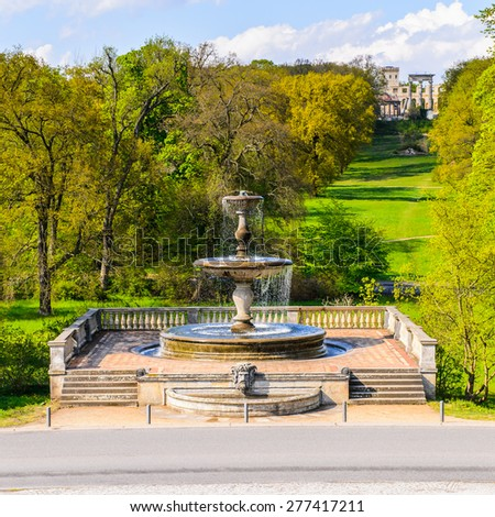 Fountain near Sanssouci Palace, the former summer palace of Frederick the Great, King of Prussia, in Potsdam, near Berlin - stock photo