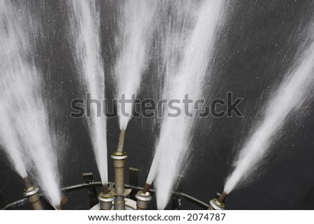 Fountain Nozzles in Flash Light - stock photo