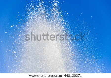 Fountain of pure brilliant water against a clear blue sky, water splashes, background - stock photo