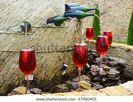 Fountain of red wine - stock photo