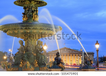 Fountain on Place de la Concorde in Paris at dusk , France - stock photo