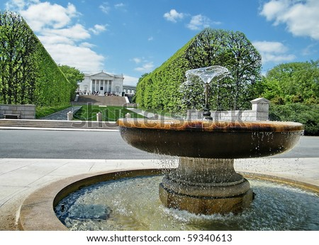 Fountain on the background of the amphitheater and the tomb of the unknown soldier in Arlington National Cemetery, Arlington Virginia USA - stock photo