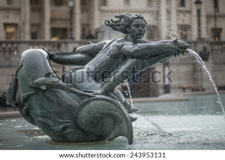 Fountain on the Trafalgar Square in London, UK - stock photo