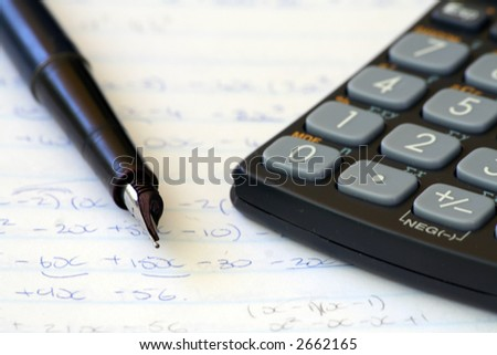 Fountain pan with calculator and mathematics - stock photo