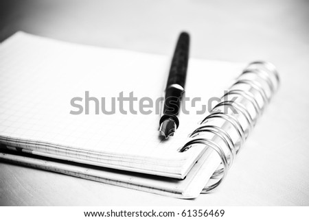 Fountain pen and notebook in composition in black and white