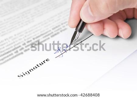 Fountain pen and signature - stock photo