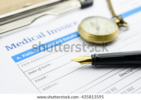 Fountain pen, antique pocket watch and a medical invoice on a clipboard. - stock photo