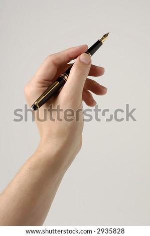 Fountain Pen in Hand - stock photo