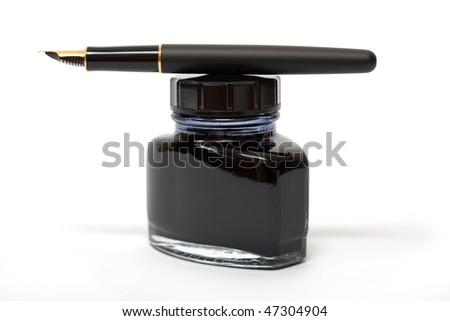 fountain pen lying on the ink bottle - stock photo