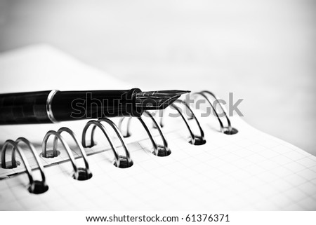 Fountain pen notebook in composition in black and white - stock photo