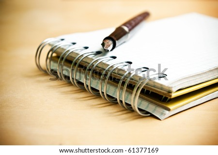 Fountain pen notebook in composition in color - stock photo
